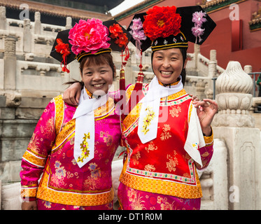 Young couple photographed in Traditional Chinese dress or Manchu from the Qin DYNASTY costume as seen at the Forbidden - Stock Photo