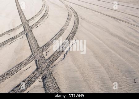 Tire tracks on beach Ocean Park - Stock Photo