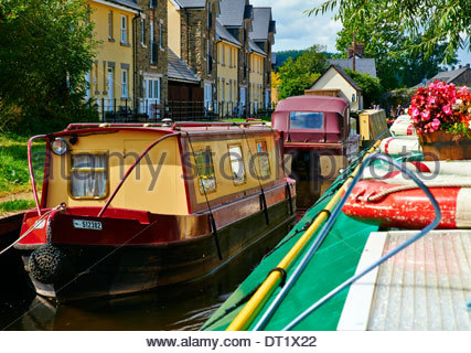 narrowboats moored on the brecon monmouth canal south wales - Stock Photo
