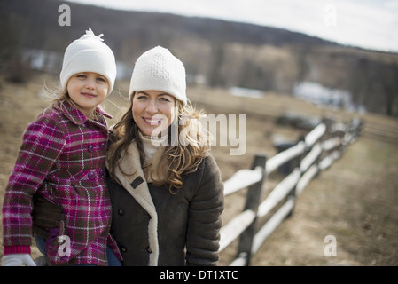 A woman and child walking along a path hand in hand - Stock Photo