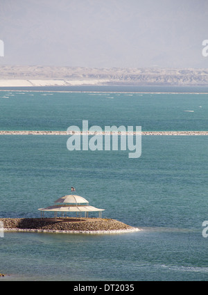Dead Sea with Salt crystals and Umbrella on the beach.Israel Stock Photo