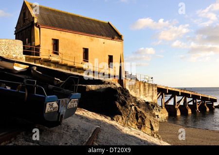 Evening light on the old Victorian lifeboat station, Polpeor Cove, Lizard Point, Cornwall, England - Stock Photo