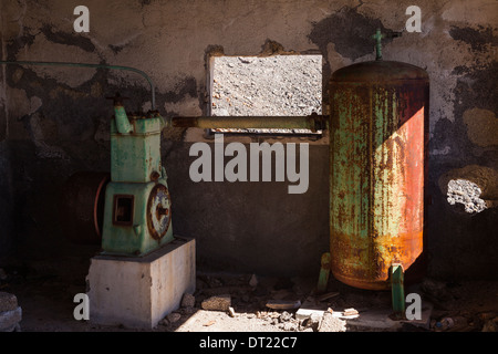 Rusty pump and tank in an abondoned pumphouse in Arguayo, Tenerife, Canary Islands, Spain. - Stock Photo