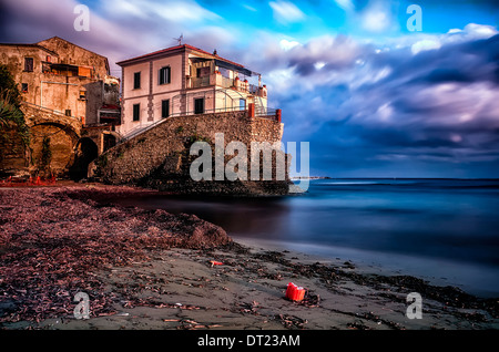 End of the day on a lonely beach in Southern Italy - Stock Photo