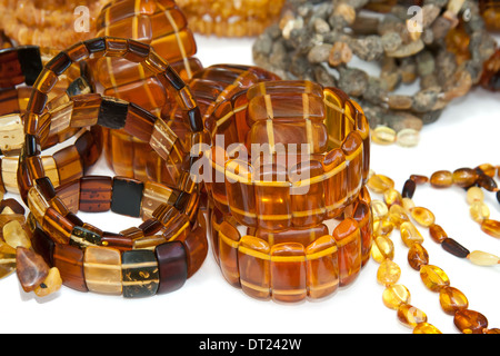 Amber necklaces on white background - Stock Photo