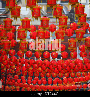 Red Lanterns hanging in London's Chinatown during Chinese New Year celebrations. - Stock Photo