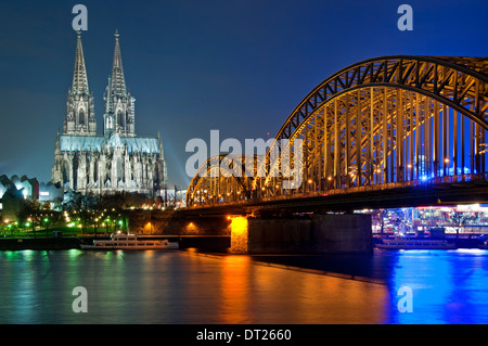 Cologne Cathedral, The Hohenzollern Bridge and River Rhine at Night, Cologne, Germany, Europe. - Stock Photo