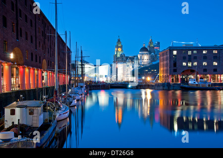 The Albert Dock at Night, with the Liver Building behind, Liverpool, Merseyside, England, UK - Stock Photo