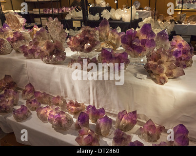 large amethyst crystals displayed for sale at the annual Gem and Mineral Show in Tucson, Arizona - Stock Photo