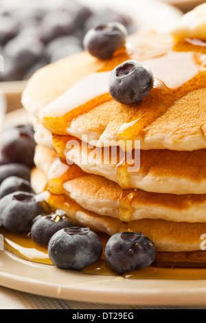 Homemade Buttermilk Pancakes with Blueberries and Syrup for Breakfast - Stock Photo