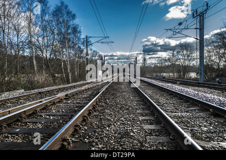 railway tracks disappearing into distance - Stock Photo