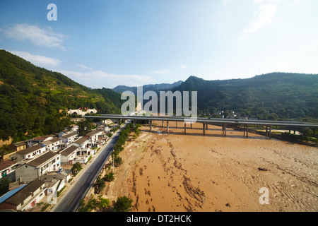 Outskirt view of China with houses on T22 Qinghai Tibet Train - Stock Photo