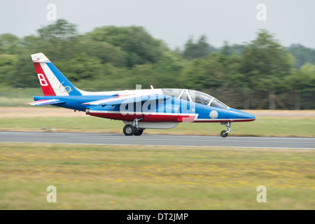 An Alpha Jet military jet trainer of the French aerobatic display team La Patrouille de France lands after displaying - Stock Photo
