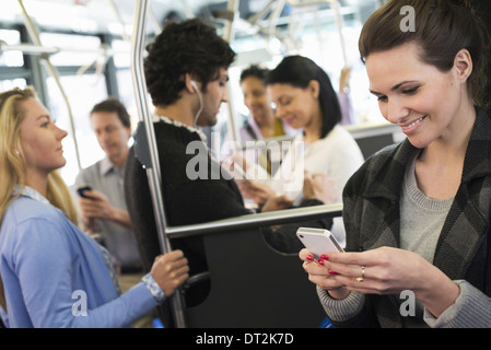 People men and women on a city bus - Stock Photo