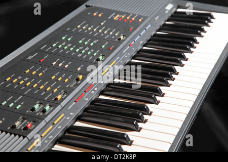 A Yamaha digital keyboard showing multiple buttons to control sounds, rhythms and automatic accompaniments - Stock Photo
