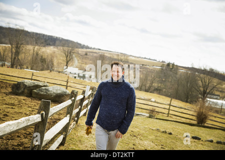 An Organic Farm in Winter in Cold Spring New York State A man working outdoors on the farm - Stock Photo