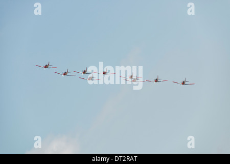 Nine Pilatus NCPC-7 Turboprop trainers of the Swiss Aerobatic PC-7 team fly in formation to begin their display - Stock Photo