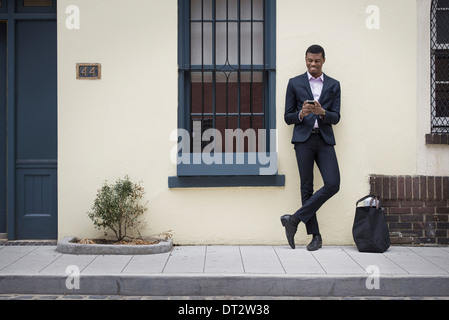 New York city street life Young people outdoors on the city streets in springtime A man leaning against a wall - Stock Photo