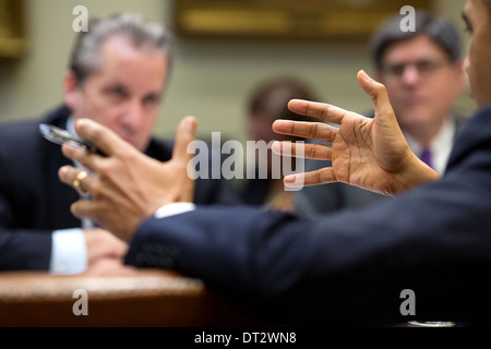 US President Barack Obama gestures during a meeting with advisors in the Roosevelt Room of the White House December - Stock Photo