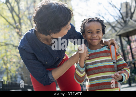 Sunshine and cherry blossom A mother and son spending time together - Stock Photo