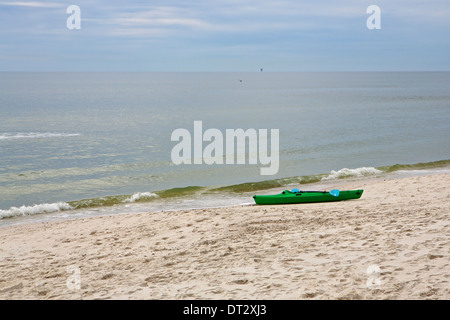 A kayak sitting on an empty beach in Bon Secour National Wildlife Refuge - Stock Photo
