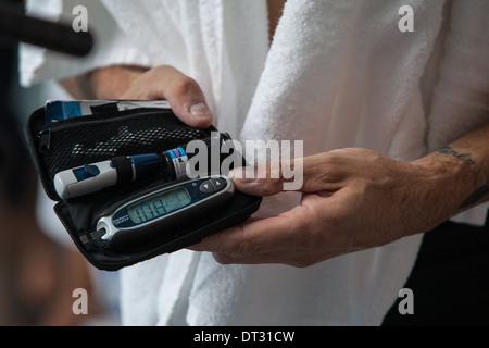 Diabetes blood test kit - Stock Photo