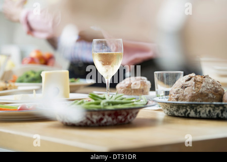 An open plan office A working lunch a salad buffet of mixed ages and ethnicities meeting together - Stock Photo