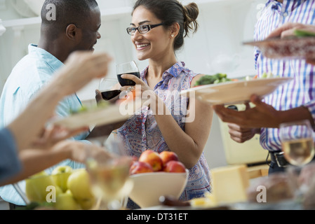 A picnic party of family adults and children - Stock Photo
