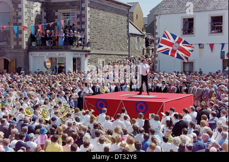 Selkirk Common Riding. A standard bearer casting the colours in Selkirk's Ancient Market Place. - Stock Photo