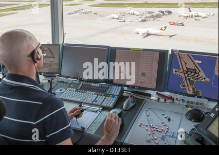 Air traffic controller in control tower at RAF Scampton, home base ...