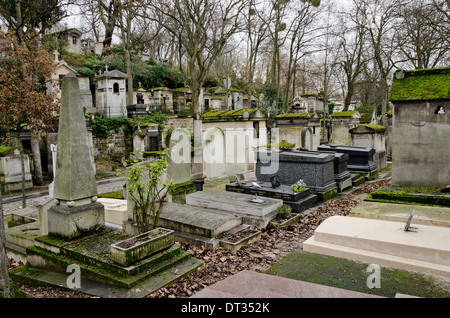 Graves and tombs of the Pere Lachaise, the largest Cemetery in Paris, France. - Stock Photo