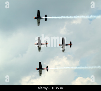 The Blades Aerobatic display team, flying their specially-built Extra 300 LPs', at Biggin Hill Air Show 2007. - Stock Photo