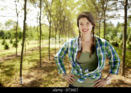 A girl in a green checked shirt with braids - Stock Photo