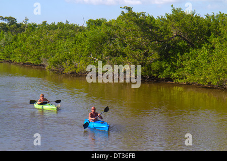 Sanibel Island Florida J.N. JN Ding Darling National Wildlife Refuge man woman couple kayaks kayaking paddling water - Stock Photo