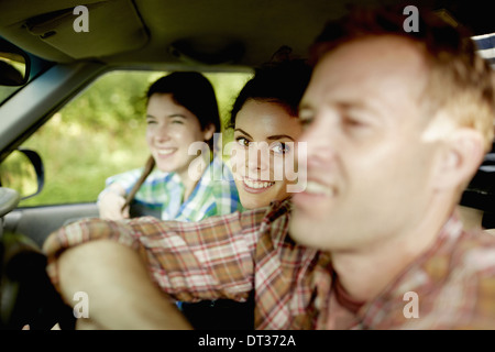 Three passengers in the cab of a pickup truck - Stock Photo