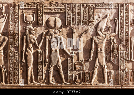 Bas relief carvings on a wall of the Ancient Egyptian Temple at Kom Ombo. - Stock Photo