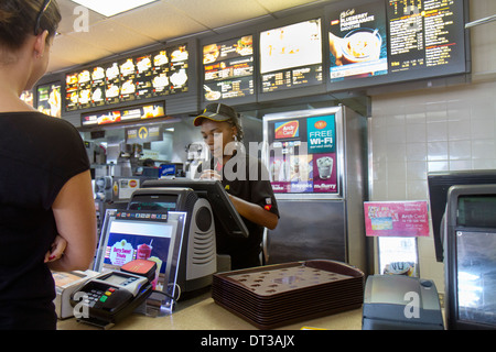 Florida Fort Pierce SR70 McDonald restaurant business fast food hamburger chain counter Black girl teen woman worker - Stock Photo