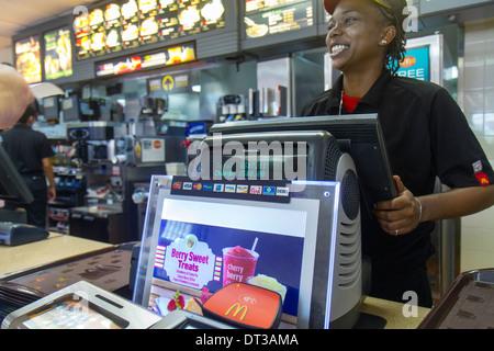 Florida Fort Pierce SR70 McDonald restaurant business fast food hamburger chain counter Black girl teen worker cashier - Stock Photo