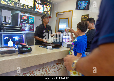 Florida Fort Pierce SR70 McDonald restaurant business fast food hamburger chain counter Black girl teen boy man - Stock Photo