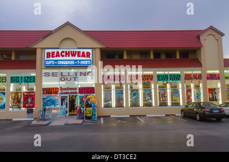 Florida Brevard County Cocoa Beach shopping Beachwear store beach gear swimwear suntan lotion sign window sale car - Stock Photo