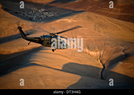 A US Army UH-60 Black Hawk helicopter flies over western Afghanistan April 12, 2012 on the way to FOB Shindand, Herat province, Afghanistan. Stock Photo