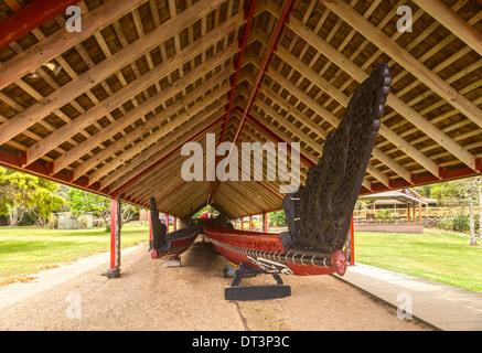 The traditionally styled boathouse on the Waitangi Treaty Grounds, Northland, New Zealand, houses two waka (canoes), - Stock Photo