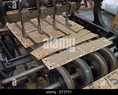 A machine for stitching together the Jacquard cards which control the pattern being woven by an automated loom. - Stock Photo