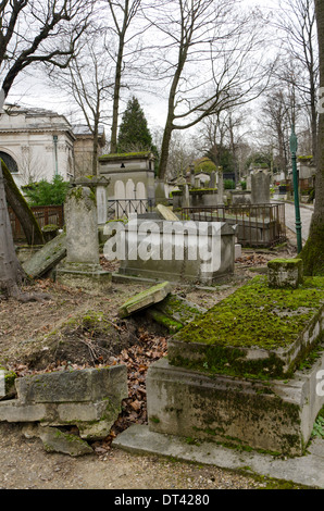 Broken tombs and graves at the Pere LachaiseCemetery , the largest Cemetery in Paris, France. - Stock Photo