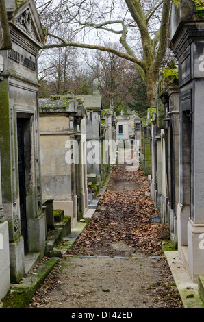 Alley of Pere Lachaise, flanked by mausoleums , the largest Cemetery in Paris, France. - Stock Photo