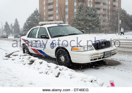 Toronto police car parked in the street during the harsh Canadian winter - Stock Photo