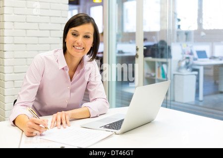 Female pretty young business happy computer desk - Stock Photo