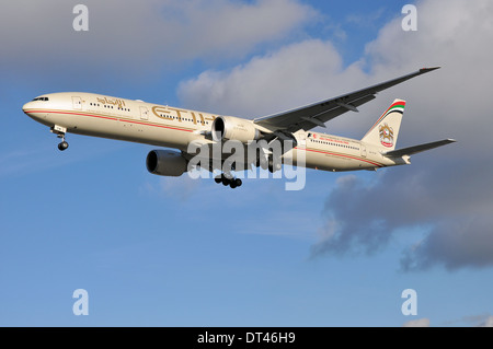 Etihad Boeing 777-300 registered A6-ETM is seen coming in to land at London Heathrow sporting advertising for the - Stock Photo