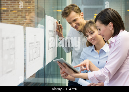 Business man woman plans meeting colleagues tablet pc - Stock Photo