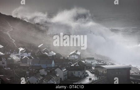 Sennen, Cornwall, UK. 8th February 2014.  Huge waves crash over Sennen In Cornwall just after high tide today. Credit: - Stock Photo